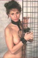 - Hals/polsboei met ketting en slot aan halsband en boeien